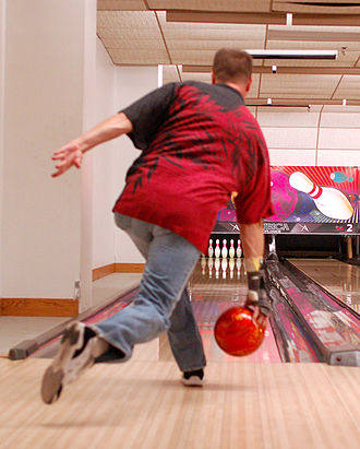 Ten-pin bowling - A bowler prepares to release his ball toward the pins during a certified bowling match.