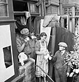 Builders are given cocoa as they make repairs to a house in London damaged by a V1 Flying Bomb in 1944. D21302.jpg