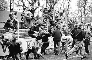 Football hooliganism - Lokomotive Leipzig fans before their team's encounter with Dynamo Schwerin in the East German FDGB-Pokal in 1990