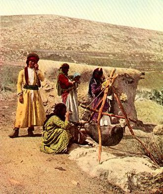Butter - Traditional butter-making in Palestine. Ancient techniques were still practiced in the early 20th century. National Geographic, March 1914.