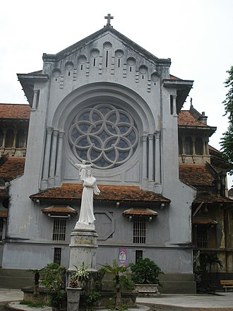 Cửa Bắc Church - South facade of the church with the statue of the Virgin Mary