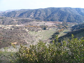 Laguna Canyon - The flat lower reach of Camarillo Canyon, with the City of Lake Forest in the upper left. Laguna Canyon cuts across the image in the middle right.