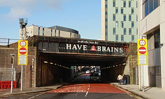 Brains Brewery - Railway bridge over Penarth Road, Cardiff: one of several painted with Brains advertising slogans