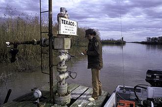 Delta National Wildlife Refuge - Checking oil well on Delta National Wildlife Refuge