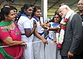 Children taking pictures with the Prime Minister, Shri Narendra Modi, during the traditional welcome ceremony, in Suva, Fiji on November 19, 2014.jpg
