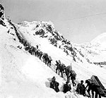 Klondikers carrying supplies ascending the Chilkoot Pass, 1898.
