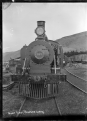 Closeup view of a the front of Wd class steam locomotive, NZR 323. ATLIB 285822.png