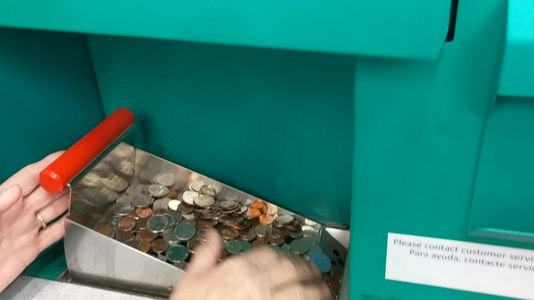 File:Coinstar machine operating.webm