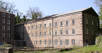 Cotton mill - Richard Arkwright's first 1771 Cromford Mill in Derbyshire, with three of its original five storeys remaining