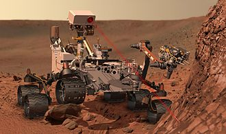 Mars rover - Artist's conception of the Curiosity rover vaporizing rock on Mars. The rover landed on Mars in August 2012.