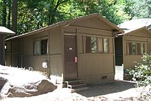 A photo of a wooden duplex cabin located in Curry Village.