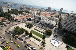 Economy of Senegal - Dakar, Senegal's place de l'Indépendance: a center of government, banking and trade. In the background is the commercial port and the tourist area, Gorée island.