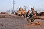 Defense.gov News Photo 111201-A-8267F-576 - U.S. Army military policemen take a knee during a patrol along a road outside Camp Taji Iraq on Dec. 2 2011. The soldiers are assigned to the.jpg