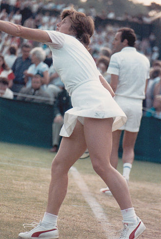 Dianne Fromholtz - Dianne Fromholtz Balestrat in Wimbledon Mixed Doubles with Tom Okker in the background; 1985