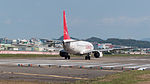 Easter Jet Boeing 737-883 HL8289 Stand by at Taipei Songshan Airport Runway 20150103.jpg
