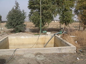 Reclaimed water - Irrigation water is pumped from this tank which stores effluent received from a constructed wetland in Haran-Al-Awamied, Syria.