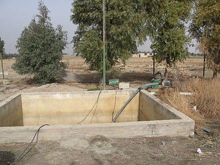 Irrigation water is pumped from this tank which stores effluent received from a constructed wetland in Haran-Al-Awamied, Syria. Effluent storage tank from where treated effluent is pumped away for irrigation (3232428204).jpg