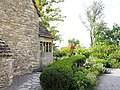 English Limestone Cottage with Garden in full bloom (9712178278).jpg
