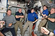 Expedition 27 and STS-134 crew members shortly after the hatches were opened