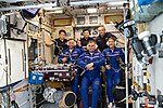 Expedition 59 welcoming ceremony inside the Zvezda service module.jpg