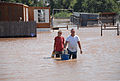 FEMA - 31657 - Couple wading though flood waters in Oklahoma.jpg