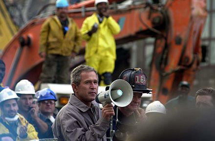 President Bush, standing with firefighter Bob Beckwith, addressing rescue workers at Ground Zero in New York, September 14, 2001 FEMA - 3905 - Photograph by SFC Thomas R. Roberts taken on 09-14-2001 in New York.jpg