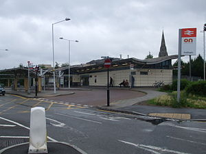 "Overground Network - Feltham railway station, with ""ON"" signage outside (far right)"