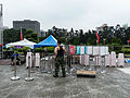 Fence Sticks, Sign Holders and Stack Stools Gathered on Square after Program 20140607.jpg