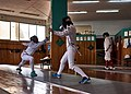 Fencing in Greece. Greek Epee Fencers. Eleftheria Mimigianni (centre) and Haris Levantidis (left) at Athenaikos Fencing Club.jpg