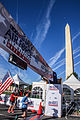 Finish line glory for the American flag at 2014 Navy-Air Force 5-Miler-Half-Marathon 140914-N-CG900-033.jpg