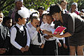 First-year students attending Niznechuiskiy School 1 recite verses from a poem during a First Bell ceremony at Niznechuiskiy village, Kyrgyzstan, Sept 120901-F-ER469-108.jpg