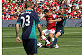 Flickr - Ronnie Macdonald - Mikel Arteta tangles with Seb Larsson.jpg