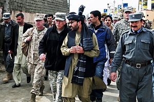 Laghman Province - U.S. Army Gen. David Petraeus walking with Governor Iqbal Azizi in 2011.