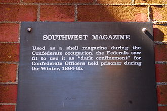 "Fort Pulaski National Monument - Sign of the southwest magazine where prisoners were kept in ""dark confinement"""