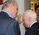Fred Thompson and John McCain share a private conversation (2072394314) (cropped1).jpg
