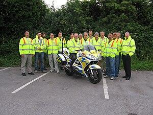 Freewheelers EVS - Freewheelers EVS members in uniform high visibility jackets