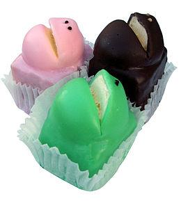 Frog cake di colore rosa, verde e marrone