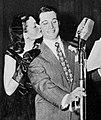 Gene Tierney kisses Perry Como, 1946.jpg