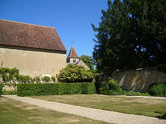 House of George Sand - The barn and garden of George Sand, and the church of Nohant. Sand's grave is in a small enclosed cemetery between the church and the garden.