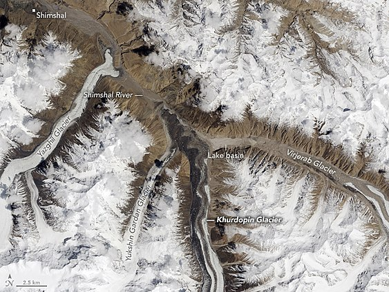 Glaciers of Shimsal Valley from space, May 13, 2017. Khurdopin glacier has dammed the Shimshal River, forming a glacial lake. The river has started to carve a path through the toe of the glacier. By early August 2017, the lake had completely drained. Glaciers of Shimsal Valley from space.jpg
