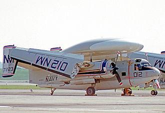 Grumman E-1 Tracer - Grumman E-1B Tracer of RVAW-110 after service aboard USS Franklin D. Roosevelt in 1976, showing the Grumman-patented Sto-Wing wing folding arrangement