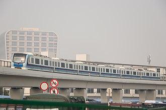 Line 5 (Guangzhou Metro) - Image: Guangzhou Metro Line 5 CSR Sifang L2 Train 023024 arriving Tanwei Station 2018 01