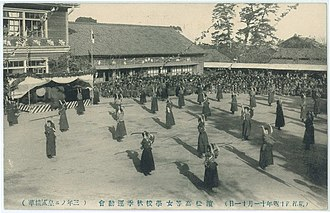 Senpai and kōhai - Demonstrating the use of the naginata at a sports festival in Hamamatsu in 1911.  Discipline training in school clubs historically has influence the senpai–kōhai system with students.