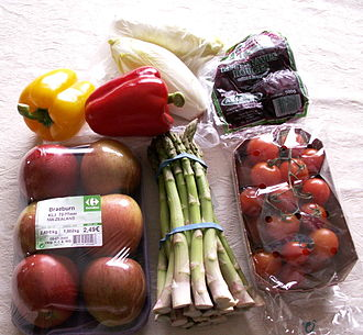 Snack - A picture of some low-calorie fruit and vegetable snacks, including apples, asparagus, beetroots, bell peppers, endives, and tomatoes.