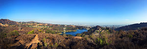 Hollywood Reservoir - The Hollywood Reservoir and the Mulholland Dam, with the Hollywood Sign in the distance to the left (2015)