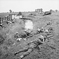 Home Guard troops 'fighting' Valentine tanks of 6th Armoured Division during large-scale manoeuvres at Yelden in Bedfordshire, 27 July 1941. H12081.jpg