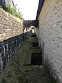 House wall buttresses, behind Stack Square, Blaenavon ironworks.jpg