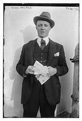 man in formal lounge suit and trilby hat