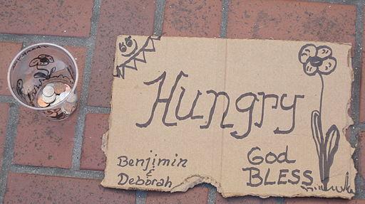 Hungry cardboard sign by Benjimin & Deborah SF