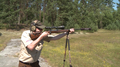 Hunter with bolt-action rifle shooting stand Sweden 02.png